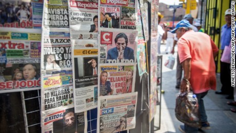 Newspapers with the portrait of former Peruvian President (2001-2006) Alejandro Toledo on their front pages, are displayed for sale in Lima on February 10, 2017. Peruvian police launched a manhunt Friday for ex-president Alejandro Toledo, once hailed as an anti-corruption champion, after a judge ordered his arrest over accusations he took $20 million in bribes from Brazilian construction company Odebrecht. / AFP / ERNESTO BENAVIDES        (Photo credit should read ERNESTO BENAVIDES/AFP/Getty Images)