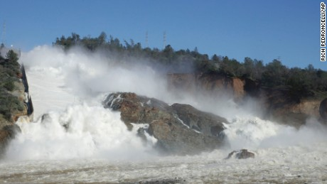 "In this Saturday, Feb. 11, 2017, water flows down Oroville Dam's main spillway, near Oroville, Calif. Officials have ordered residents near the Oroville Dam in Northern California to evacuate the area Sunday, Feb. 12, saying a ""hazardous situation is developing"" after an emergency spillway severely eroded. (AP Photo/Rich Pedroncelli)"