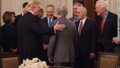 US President Donald Trump speaks with Senate Majority Leader Mitch McConnell (L) as House Minority Leader Nancy Pelosi (L) Senate Minority Leader Chuck Schumer (3rd L) House Majority Leader Kevin McCarthy (3rd R), Vice President Mike Pence (2nd L) and Senate Majority Whip John Cornyn (R) during a reception with Congressional leaders on January 23, 2017 at the White House in Washington, DC. / AFP / NICHOLAS KAMM