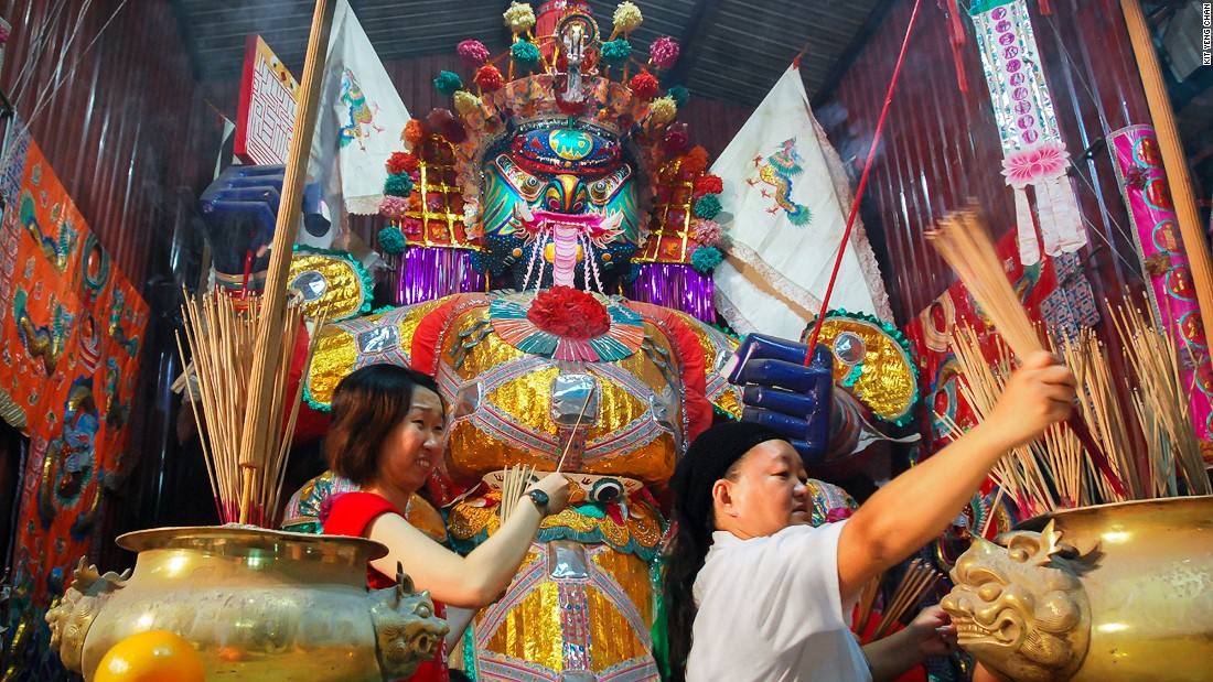 <strong>Hungry Ghost Festival: </strong>According to legend, during the seventh month of the Lunar year, King of Hell Tai Su Yah opens the gates of the netherworld, unleashing the dead upon the Earth. Penang's lanes and street corners fill up with lean-tos housing impromptu shrines, each adorned with one watchful paper statue of Tai Su Yah.