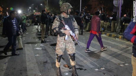 Police and security officers cordon off the area of a deadly bombing, in Lahore, Pakistan, on Monday, February 13, 2017.