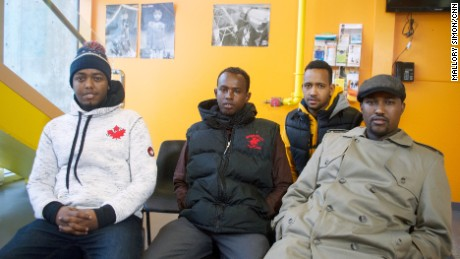 Hussein Ahmed, far right, and Mohamed Hossain, far left, thought they might die during the icy trek this weekend from Minnesota to Canada.