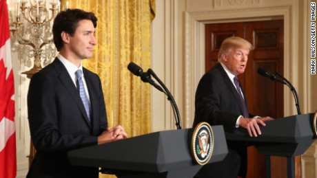 Trump defends ban, Trudeau has opposing view