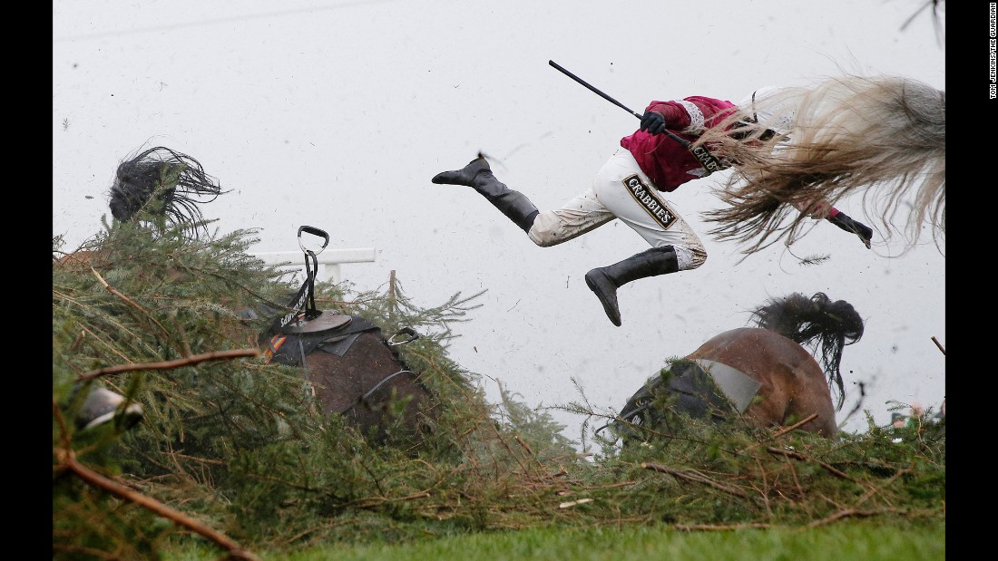 Jockey Nina Carberry flies off her horse, Sir Des Champs, during the Grand National steeplechase in Liverpool, England, on April 9.
