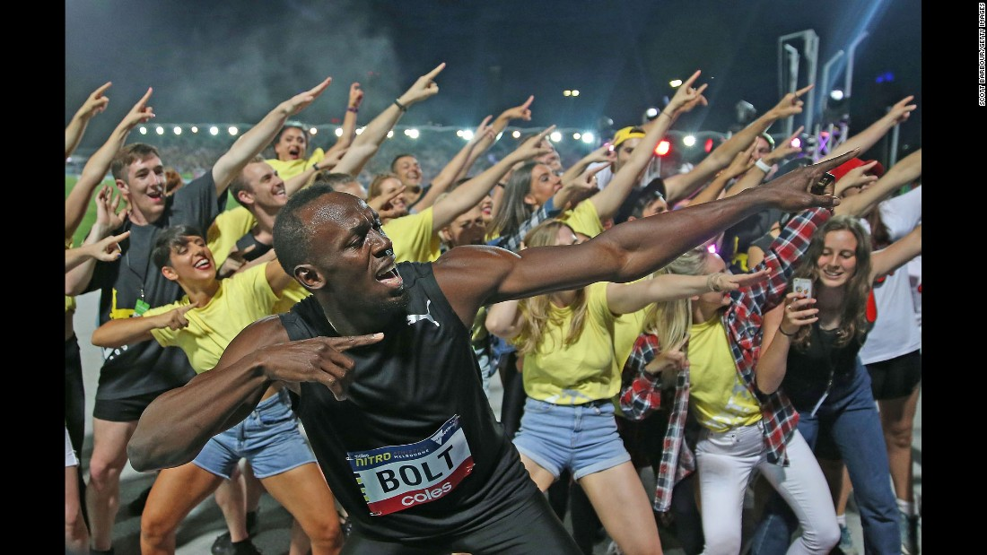 Olympic champion Usain Bolt celebrates after winning a 150-meter race at a Nitro Athletics meet in Melbourne on Saturday, February 11.