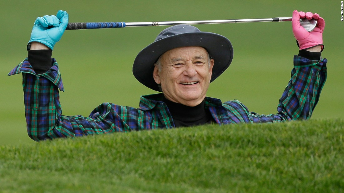 Actor Bill Murray prepares to hit out of a bunker during a celebrity challenge event in Pebble Beach, California, on Wednesday, February 8.
