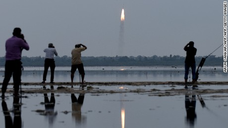 TOPSHOT - Indian residents photograph the launch of the Indian Space Research Organisation (ISRO) Polar Satellite Launch Vehicle (PSLV-C35), carrying equipment which will be used to monitor oceans and weather at Sriharikota in the state of Andhra Pradesh on September 26, 2016. The rocket is also carrying satellites from Algeria, Canada and the US. / AFP / ARUN SANKAR        (Photo credit should read ARUN SANKAR/AFP/Getty Images)