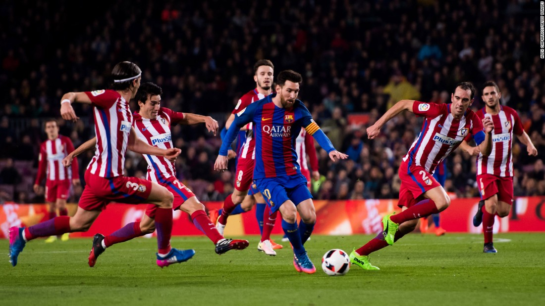 Barcelona star Lionel Messi is swarmed by Atletico Madrid players during a Copa del Rey match in Barcelona, Spain, on Tuesday, February 7. Barcelona advanced to the tournament final with a 3-2 score over two legs.