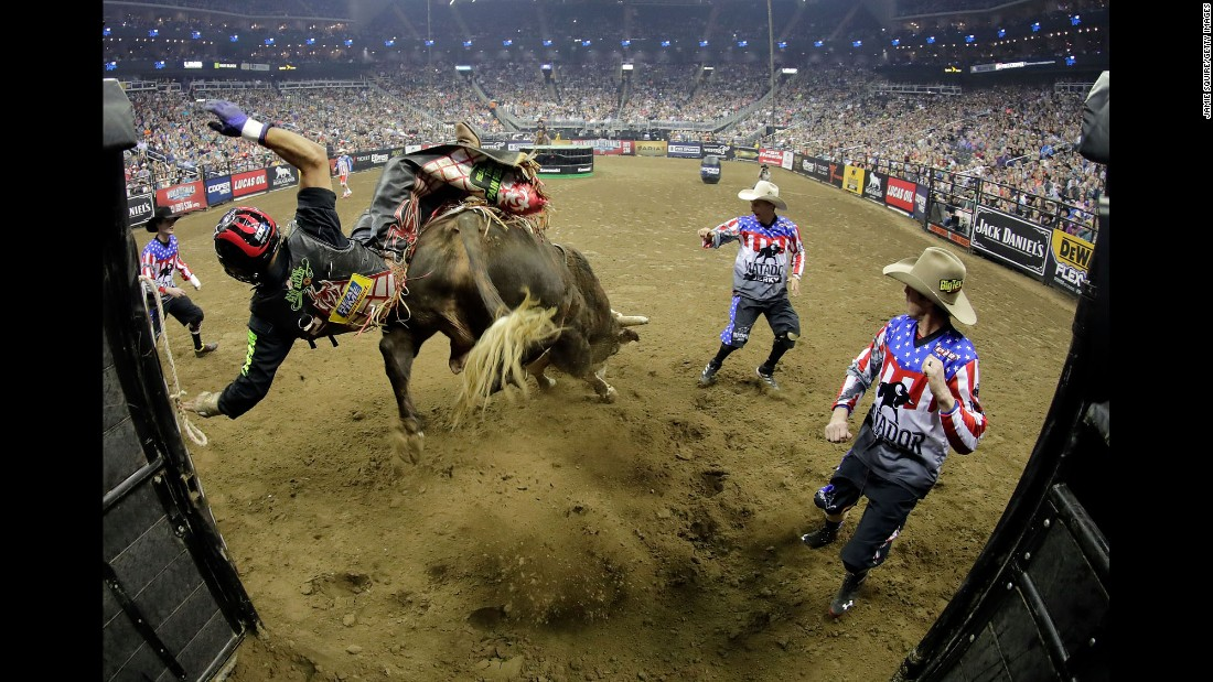 Luis Blanco is thrown from Swamp Wreck during a Professional Bull Riders event in Kansas City, Missouri, on Saturday, February 11.
