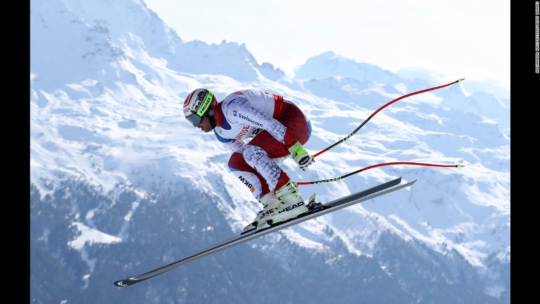Swiss skier Beat Feuz soars through the air on his way to winning downhill gold at the World Championships in St. Moritz, Switzerland, on Sunday, February 12.