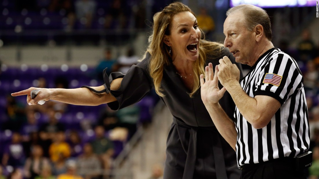 TCU head coach Raegan Pebley talks to official Bob Trammell during a college basketball game in Fort Worth, Texas, on Sunday, February 12.