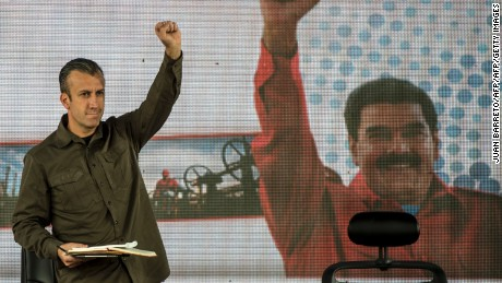 Venezuelan President Nicolas Maduro (not framed) and his vice-president Tareck El Aissami (L) participate in a rally with workers of PDVSA state-owned oil company in Carcas January 31, 2017.  Maduro broadened the powers of his hardline number two in a decree Tuesday that analysts said showed he may be grooming him to take over as president. / AFP / JUAN BARRETO        (Photo credit should read JUAN BARRETO/AFP/Getty Images)