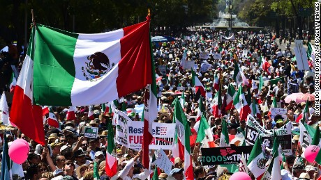"Thousands of Mexicans take part in an anti-Trump march in Mexico City, on February 12, 2017. Mexicans took to the streets against US President Donald Trump, hitting back at his anti-Mexican rhetoric and vows to make the country pay for his ""big, beautiful"" border wall. / AFP / RONALDO SCHEMIDT        (Photo credit should read RONALDO SCHEMIDT/AFP/Getty Images)"