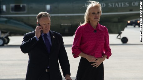 Spicer and Conway wait for Trump's arrival at Andrews Air Force Base