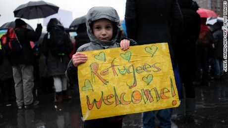 A boy holds a placard during a  Jewish rally for refugees in New York on February 12, 2017.