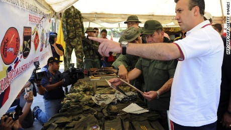 "Interior and Justice Minister Tareck El Aissami (R) shows clothes, bags and other stuff found in a drug lab dismantled by the frontier national guard, to the press in Tachira, Venezuela, on August 10, 2011. The Minister gave a press conference to show the achievements and new phase of ""Operation Sierra"" which seeks to combat drug trafficking in the frontier with Colombia.  AFP PHOTO/Leo RAMIREZ (Photo credit should read LEO RAMIREZ/AFP/Getty Images)"