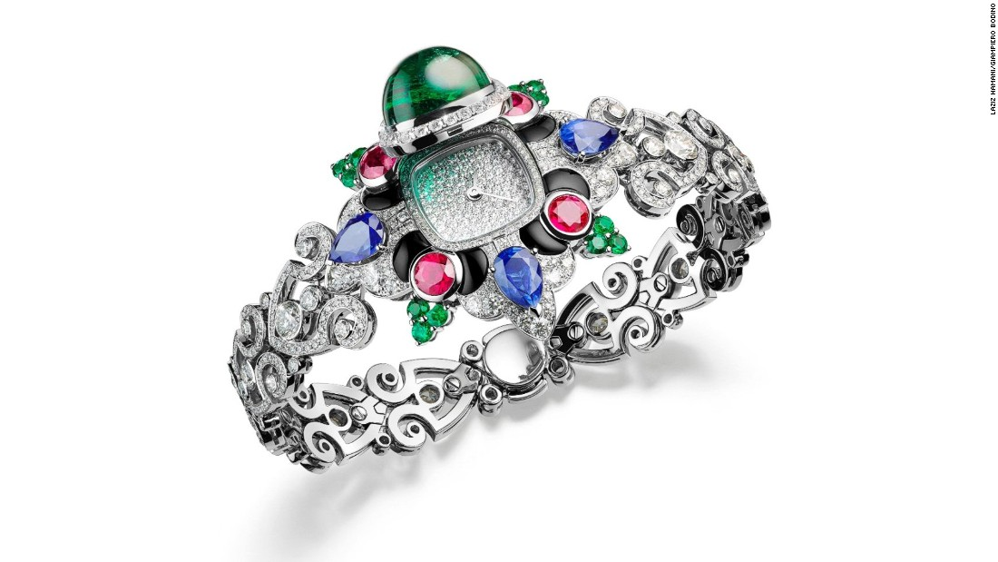 The pavé diamond dial on this watch is hidden beneath an 11.49-carat cabochon emerald, and surrounded by colored sapphires, emeralds and rubies.