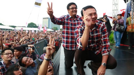 "In this Saturday, Feb. 11, 2017 photo, incumbent Jakarta Governor Basuki Tjahaja Purnama, right, and his deputy and also running mate Djarot Saiful Hidayat pose for photographers as they attend a campaign rally in Jakarta, Indonesia. Purnama, popularly known as ""Ahok"", the first ethnic Chinese governor of Jakarta and the first Christian in more than half a century, had seemed unassailably popular until the accusation of blasphemy, a criminal offense in Indonesia, surfaced in September. Protests against him in November and December, organized by hard-line Islamic groups, drew hundreds of thousands to Jakarta's streets and shook the centrist-minded government of President Joko ""Jokowi"" Widodo. (AP Photo/Dita Alangkara)"