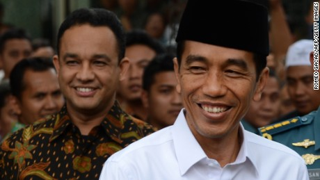 Indonesian President Joko Widodo (R) with Anies Baswedan (L) at the presidential palace in Jakarta on October 24, 2014.