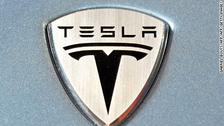 The logo of theTesla Roadster electric car is seen in the new showroom in Los Angeles, May 6, 2008. Tesla Motors develops and manufactures electric sport vehicles, while conforming to all US safety, environmental and durability standards. The 2008 model year is sold out and Tesla is currently taking reservations for the 2009 model year Tesla Roadster. To date, over 1,000 Tesla Roadsters have been reserved in total. With a 0-60 mph acceleration of 3.9 seconds, a 13,000 rpm redline, combined with an EPA rating of 135 MPG equivalent, the Tesla Roadster is unique in providing super car performance at twice the energy efficiency of the best hybrids. AFP PHOTO / GABRIEL BOUYS (Photo credit should read GABRIEL BOUYS/AFP/Getty Images)
