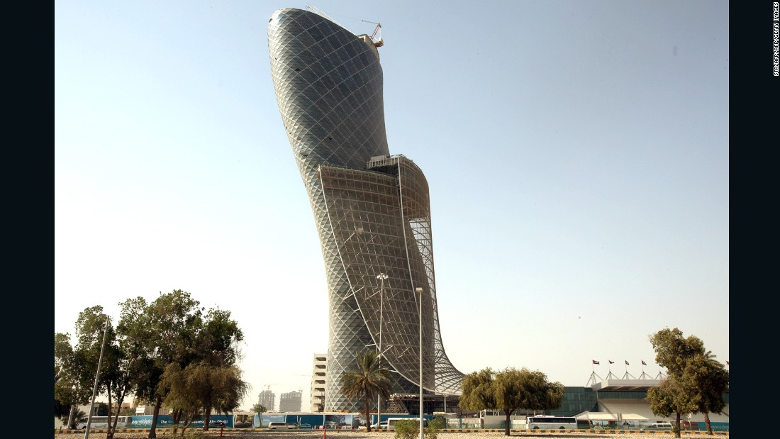 "The curvaceous 540 foot (165 meter) tall <a href=""http://www.capitalgate.ae/"" target=""_blank"">Capital Gate</a> building is now an iconic part of the Abu Dhabi skyline. Designed by British architects <a href=""https://www.rmjm.com/the-architects-perspective-the-capital-gate/"" target=""_blank"">RMJM</a> to tilt 18 degrees to the west -- more than four times the angle of the Tower of Pisa -- it is recognized as the ""furthest-leaning man-made tower"" in the world by <a href=""http://www.guinnessworldrecords.com/world-records/farthest-manmade-leaning-building"" target=""_blank"">Guinness World Records</a>."