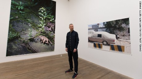 Wolfgang Tillmans stands in his exhibition at London's Tate Modern.