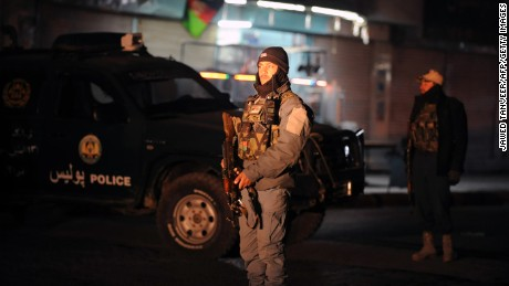 An Afghan police officer stands guard at the Kandahar governor's compound after the January 10 blast.