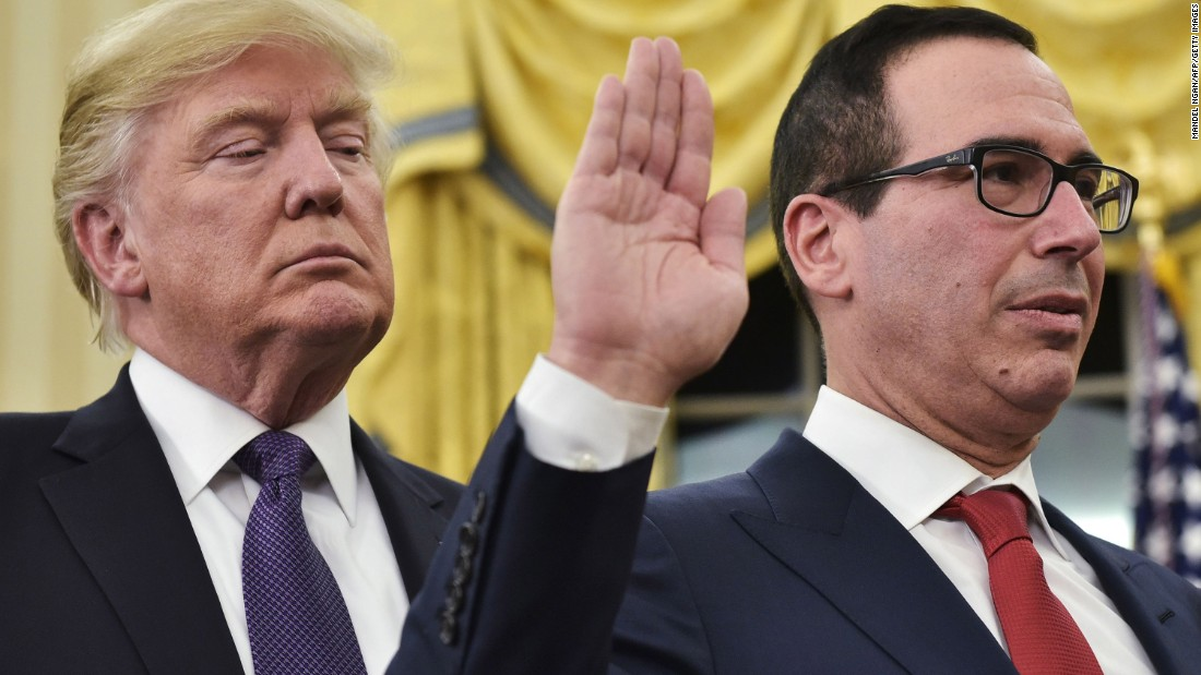 "Trump watches as Steven Mnuchin is <a href=""http://www.cnn.com/2017/02/13/politics/steven-mnuchin-senate-confirmation-vote-david-shulkin/"" target=""_blank"">sworn in as treasury secretary</a> on Monday, February 13. The Senate vote was 53-47, mostly along party lines."