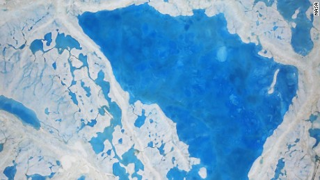 This large pool of melt water over sea ice was seen from an Operation IceBridge flight over the Beaufort Sea on July 14, 2016. During this summer campaign, IceBridge will map the extent, frequency and depth of melt ponds like these to help scientists forecast the Arctic sea ice yearly minimum extent in September.