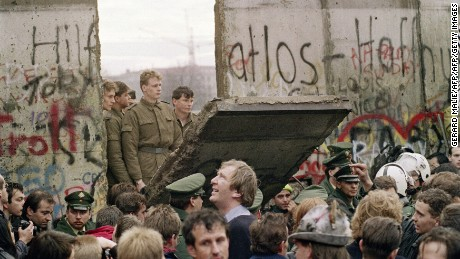 "TO GO WITH AFP STORY by  Audrey KAUFFMANN and PACKAGE ""Germany-east-History-20years""  FILES - West Berliners crowd in front of the Berlin Wall early 11 November 1989 as they watch East German border guards demolishing a section of the wall in order to open a new crossing point between East and West Berlin, near the Potsdamer Square. Two days before, Gunter Schabowski, the East Berlin Communist party boss, declared that starting from midnight, East Germans would be free to leave the country, without permission, at any point along the border, including the crossing-points through the Wall in Berlin. The Berlin concrete wall was built by the East German government in August 1961 to seal off East Berlin from the part of the city occupied by the three main Western powers to prevent mass illegal immigration to the West. According to the ""August 13 Association"" which specialises in the history of the Berlin Wall, at least 938 people - 255 in Berlin alone - died, shot by East German border guards, attempting to flee to West Berlin or West Germany.   AFP PHOTO / GERARD MALIE (Photo credit should read GERARD MALIE/AFP/Getty Images)"