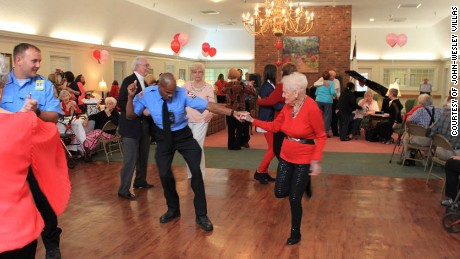 Firefighters join residents of John-Wesley Villas in Georgia and bring out their best dance steps.