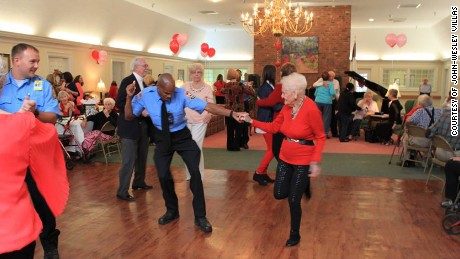 Macon-Bibb County fireman takes to the dance floor with a senior citizen during Valentine's Sweetheart Ball at John-Wesley Villas. Courtesy of John-Wesley Villas
