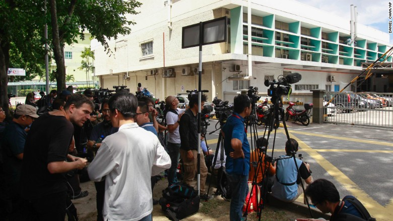 Journalists gather outside the forensic department of a hospital in Kuala Lumpur, Malaysia, Wednesday, Feb. 15, 2017.