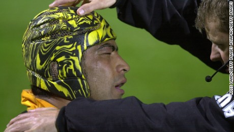 NEW ZEALAND - AUGUST 19:  Wellington's Inoke Afeaki is checked by team physio Glen Muirhead, after a knock to the head in the Air New Zealand 1st division NPC match against Otago, at Carisbrook, Dunedin, Saturday. Wellington won 106.  (Photo by Ross Land/Getty Images)
