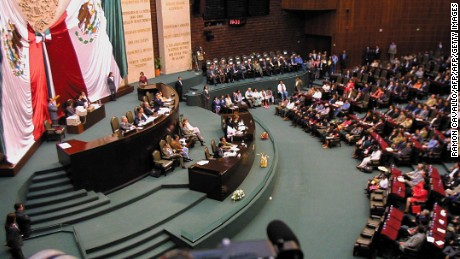 MEXICO CITY, MEXICO - MARCH 28:  This photo shows a general view of the deputee chamber in Mexico City, during the address of the EZLN leadership 28 March 2001 to senators and deputees regarding the approval the law Rights and Indingenous Culture.   Vista general de la camara de diputados de Mexico, durante uno de los discursos de la comandancia general del EZLN, el 28 de Marzo de 2001, ante la presencia de diputados y senadores que estudian la aprobacion de la ley de Derechos y Cultura Indigena, que se llevo a cabo sin la presncia del subcomandante Marcos.  (Photo credit should read RAMON CAVALLO/AFP/Getty Images)