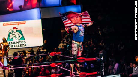 Sam Adonis waves a Donald Trump flag as he is introduced to the crowd at Arena Mexico on Sunday, February 12, 2017.