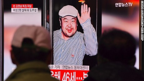 People watch a television showing news reports of Kim Jong-Nam, the half-brother of North Korean leader Kim Jong-Un, at a railway station in Seoul on February 14, 2017.