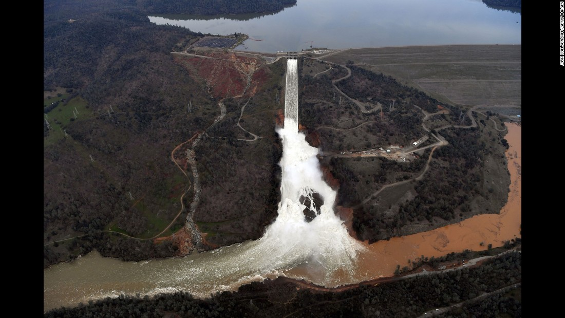 "Water gushes over the main spillway at the Oroville Dam in Oroville, California, on Monday, February 13. Earlier this week, authorities ordered mandatory evacuations over concerns that an emergency spillway at the dam could fail and threaten nearby communities. Officials eventually <a href=""http://www.cnn.com/2017/02/16/us/california-oroville-dam-storm-spillway/"" target=""_blank"">downgraded the evacuation order</a> to a warning, allowing 188,000 evacuees to return home."