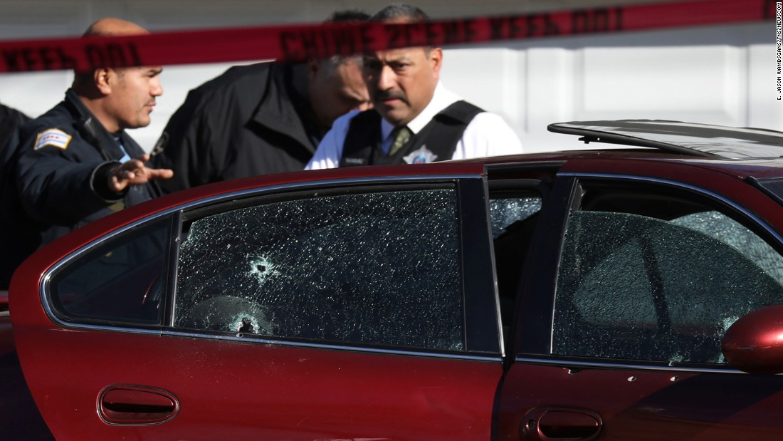 "Police stand where two people were killed and one was wounded after a shooting in Chicago's Lawndale neighborhood on Tuesday, February 14. The shooting <a href=""http://www.cnn.com/2017/02/14/us/chicago-toddler-killed/"" target=""_blank"">claimed the lives of a toddler and a 26-year-old man.</a>"