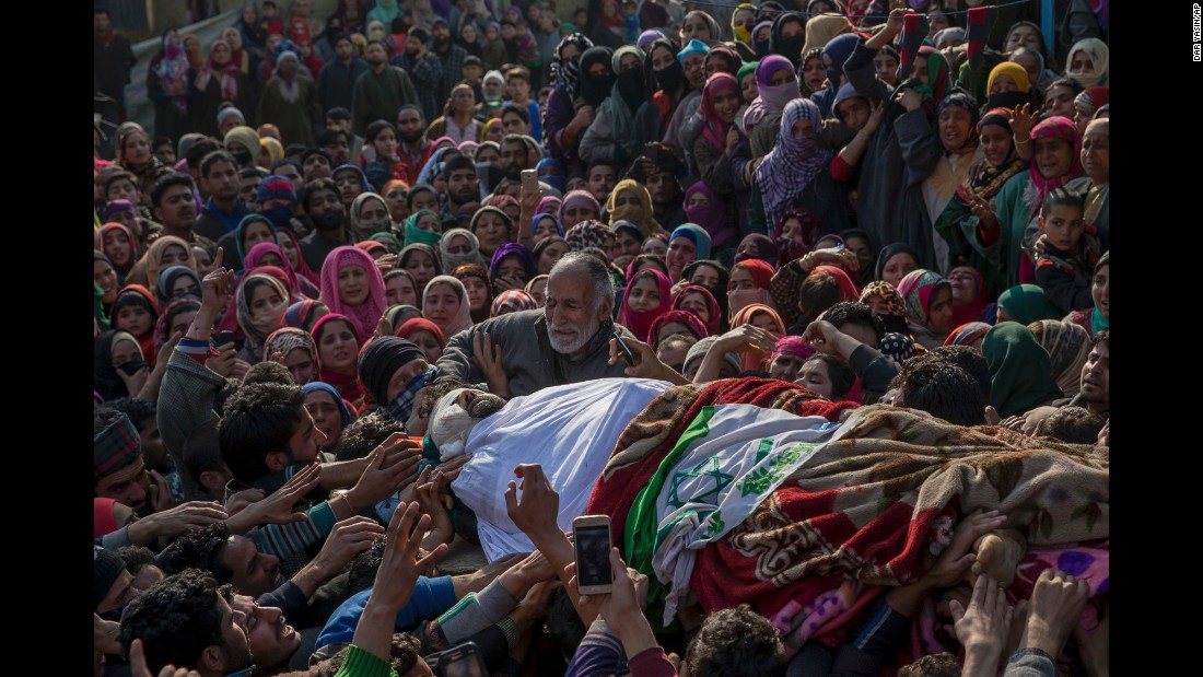 "The father of Mudasir Ahmed cries over the body of his son, one of four suspected rebels killed in a gun battle in Indian-controlled Kashmir on Sunday, February 12. Two Indian soldiers and a civilian were also killed, officials said. <a href=""http://www.cnn.com/2016/09/30/asia/kashmir-explainer/"" target=""_blank"">Read more: The Kashmir dispute explained</a>"