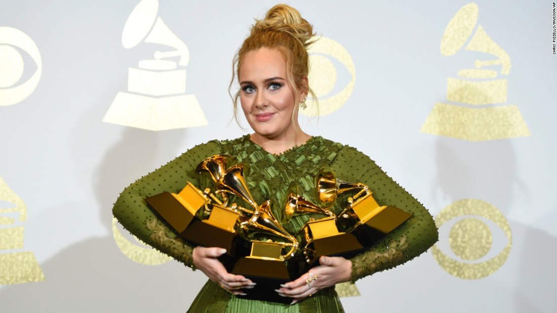 "Adele poses with the five Grammy Awards she won on Sunday, February 12. <a href=""http://www.cnn.com/2017/02/12/entertainment/grammys-2017/index.html"" target=""_blank"">She swept the top honors,</a> including album of the year and song of the year (""Hello"")."