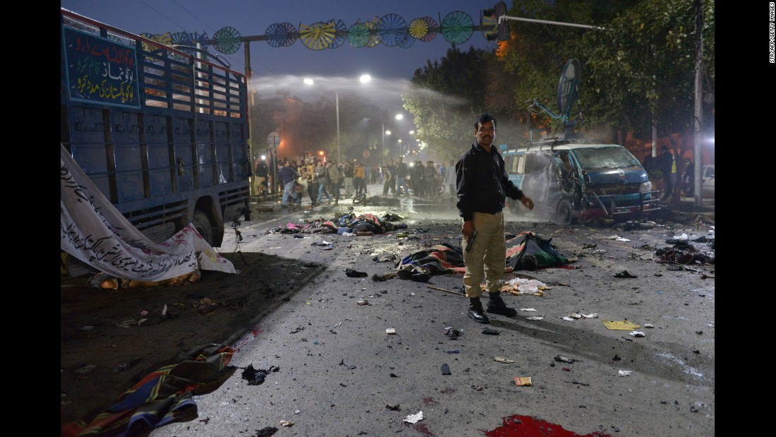 "A police officer stands at the site of <a href=""http://www.cnn.com/2017/02/13/world/lahore-blast-dead/"" target=""_blank"">a deadly explosion</a> in Lahore, Pakistan, on Monday, February 13. Jamat-ul-Ahrar, a splinter group of Pakistan's Tehreek-i Taliban -- also known as the Pakistani Taliban -- claimed responsibility for the attack. At least 14 people were killed and 59 injured, according to government spokesman Malik Ahmad Khan."