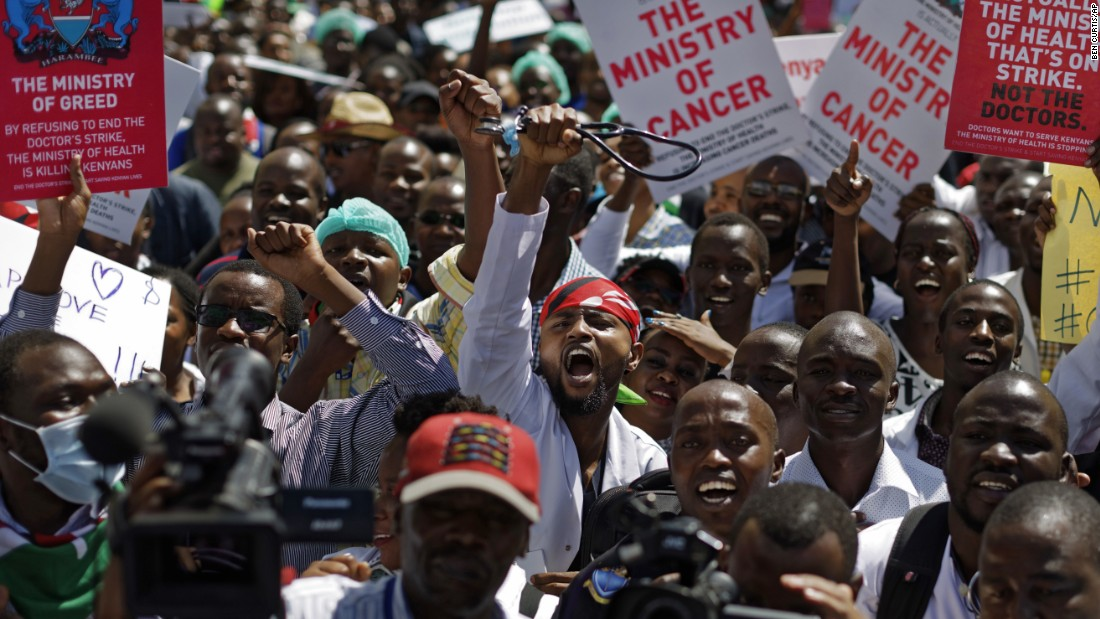A doctor holds his stethoscope in the air as he and other medical staff protest the detention of their union leaders in Nairobi, Kenya, on Wednesday, February 15. Seven union leaders were jailed earlier this week for not calling off a strike by doctors working in public institutions. Their release was later ordered by an appeals court.