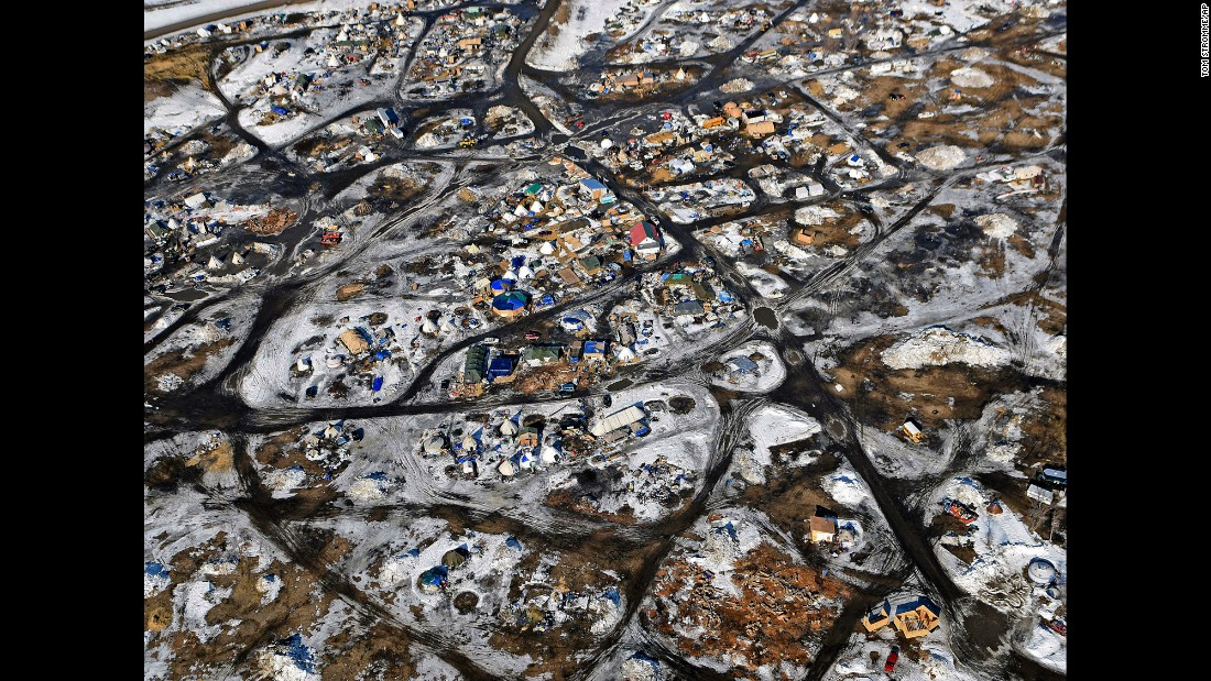 "This aerial photo, taken on Monday, February 13, shows the Oceti Sakowin camp where people have gathered <a href=""http://www.cnn.com/2016/09/09/us/gallery/north-dakota-oil-pipeline/index.html"" target=""_blank"">to protest the Dakota Access Pipeline</a> in Cannon Ball, North Dakota. The pipeline is a $3.7 billion project that would cross four states and change the landscape of the US crude oil supply. The Standing Rock Sioux tribe says the pipeline would affect its drinking-water supply and destroy its sacred sites."