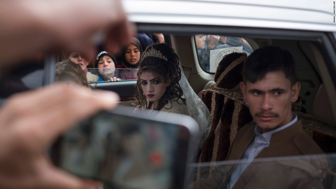 "Hussein Zeino Danoon and Shahad Ahmed Abed sit inside a car after marrying in the Khazer refugee camp in Iraq on Thursday, February 16. The camp is east of Mosul, where an Iraqi-led coalition <a href=""http://www.cnn.com/2016/10/17/world/gallery/mosul/index.html"" target=""_blank"">has been fighting ISIS militants.</a>"