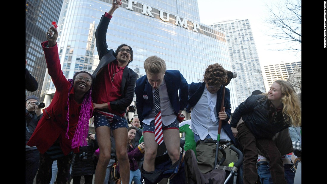 Protesters pull down their pants to moon Trump Tower in Chicago on Sunday, February 12.