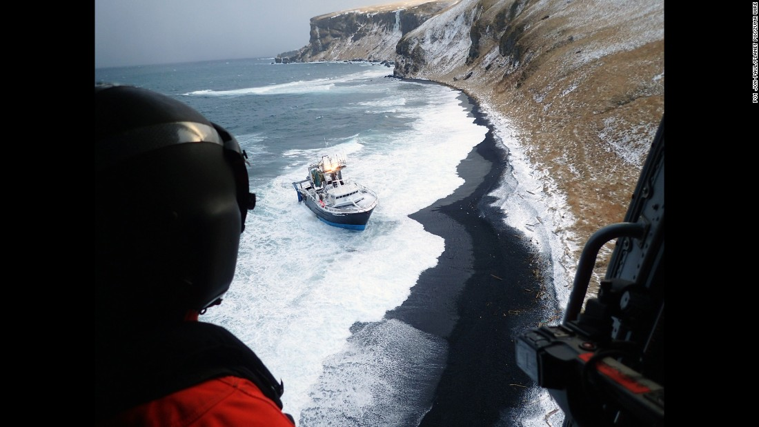 A US Coast Guard crew prepares to rescue people from a fishing boat that ran aground in Cold Bay, Alaska, on Tuesday, February 14.