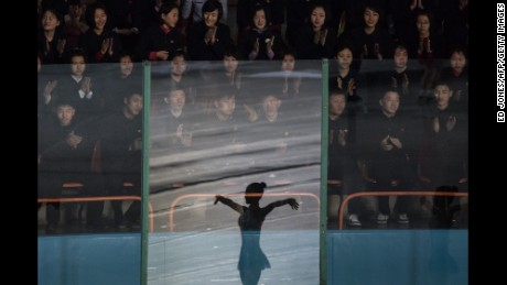 TOPSHOT - Spectators watch figure skaters perform at the Paektusan Prize International Figure Skating Festival in Pyongyang on February 15, 2017.