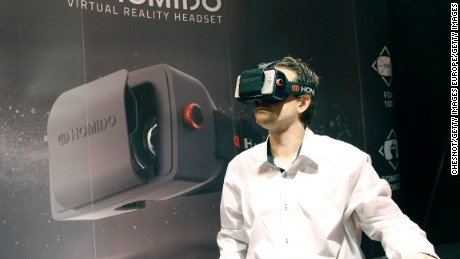 PARIS, FRANCE - OCTOBER 27:  A gamer plays a game with the virtual reality head-mounted display 'Homido' during the 'Paris Games week' at Parc des Expositions Porte de Versailles on October 27, 2015 in Paris, France. The display transfers the eye movements to the game in real time. 'Paris Games week' takes place from October 28, 2015 until November 01, 2015.  (Photo by Chesnot/Getty Images)