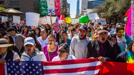 AUSTIN, TX - FEBRUARY 16:  Protesters march in the streets outside the Texas State Capital on 'A Day Without Immigrants' February 16, 2017 in Austin, Texas.   (Photo by Drew Anthony Smith/Getty Images)